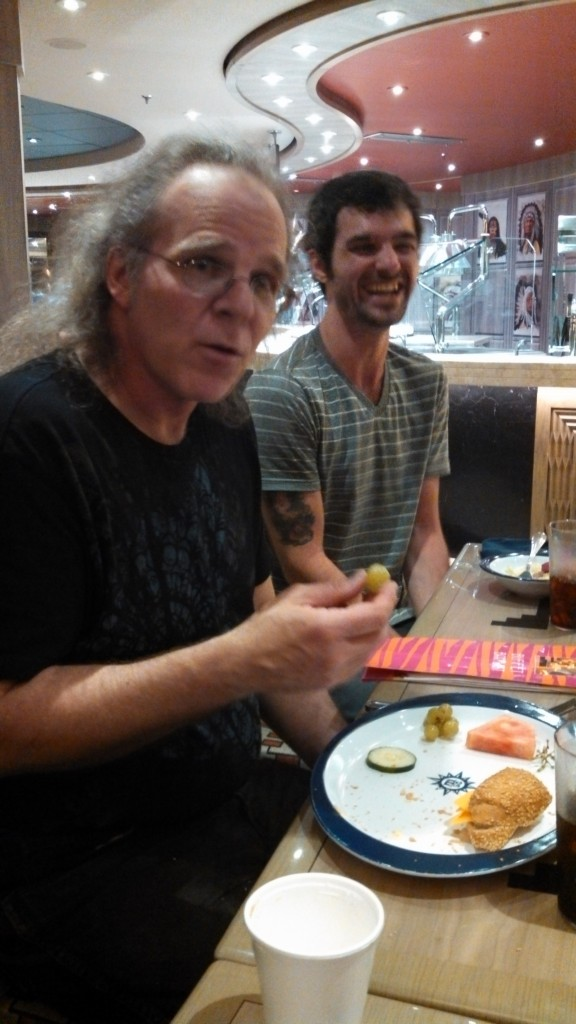 Tom Tutino (composer/guitars/vocals, , Prog Rock Orchestra) so rarely eats fruit or vegetables that this moment had to be captured.  Tom's son Anthony (musician/guitar tech) is laughing because he can't believe it!