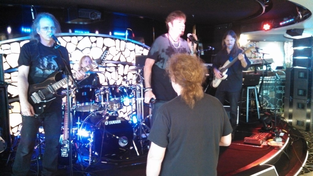Brook Hansen leading the Prog Rock Orchestra rehearsal.  Tim Marshall (lead vocals) is center stage.