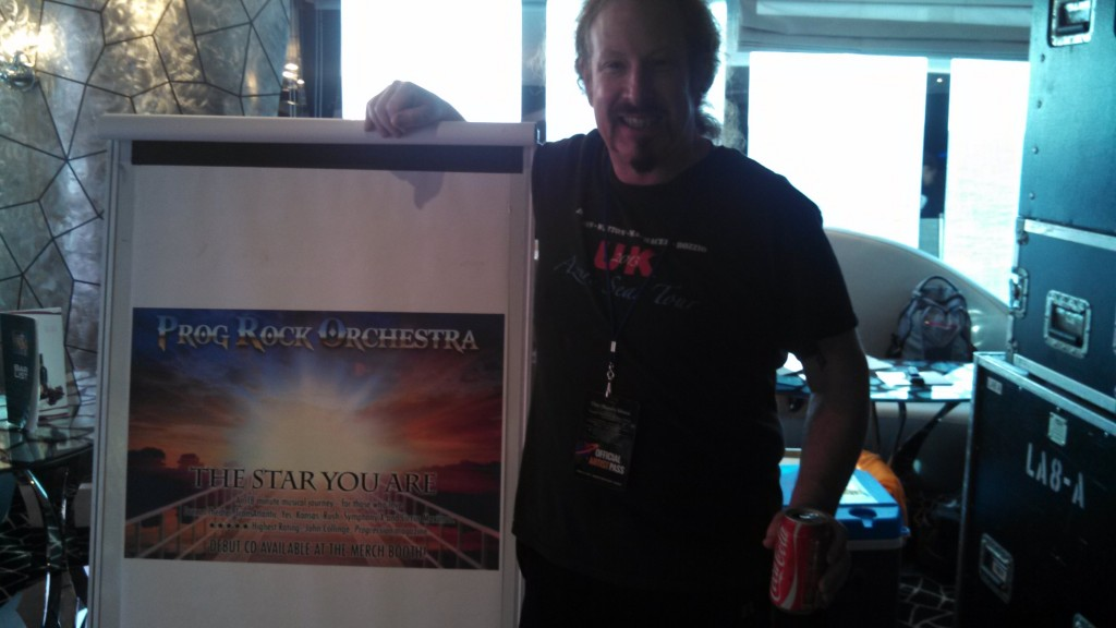 Prog Rock Orchestra co-founder and leader Brook Hansen with the promo poster for the first album.
